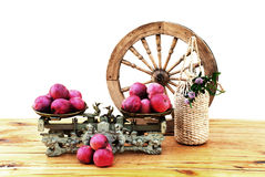 Apples on the old mechanical scales. Autumn apples, vintage mechanical scales and a bottle of cider on wooden table Stock Image