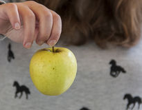 Apples. One hand holding one apple Royalty Free Stock Photo