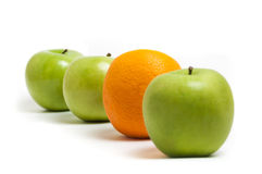 Apples and an orange. On a white background Stock Photos