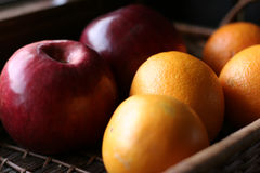 Apples and oranges. In the basket Stock Image