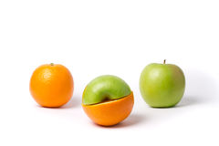 Apples and oranges. On white background Royalty Free Stock Photo