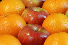 Apples and Oranges. Fresh wholesome apples and oranges royalty free stock image