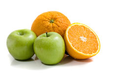 Apples and oranges. Isolated on white Royalty Free Stock Image