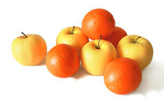 Apples and oranges. On a white background Royalty Free Stock Image
