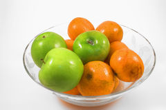 Apples and oranges in bowl Royalty Free Stock Photos
