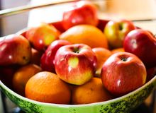 Apples and oranges fruit plate. Red apples and oranges fruit plate royalty free stock photos