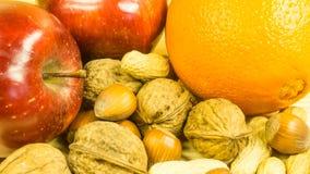 Apples, oranges, hazelnuts, Royalty Free Stock Photos