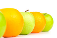 Apples and oranges in row Royalty Free Stock Photography