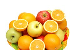 Apples and oranges in the tray. Isolated on the white Royalty Free Stock Image