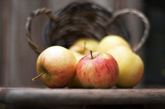 Apples out of basket Royalty Free Stock Photography