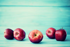 Free Apples Over Turquoise Wood Stock Photos - 59503813