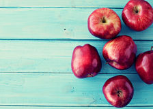 Apples over turquoise wood Royalty Free Stock Photos