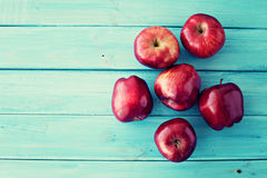 Apples over turquoise wood Stock Photography