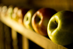 Apples over a wooden railing Royalty Free Stock Photo