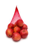 Apples packaged in the red net Stock Images