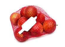Apples packaged in the red net Royalty Free Stock Images