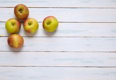 Apples. On a painted wooden background Royalty Free Stock Images