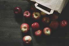 Apples and the paper bag Royalty Free Stock Image