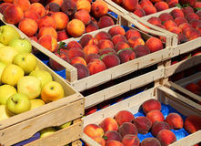 Apples and peaches for sale at market fruit in summer Stock Photos