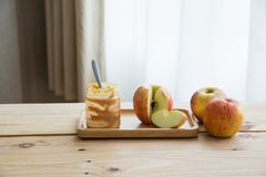 Apples with peanut butter royalty free stock photos