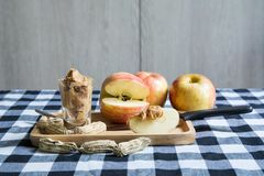 Apples with peanut butter royalty free stock image