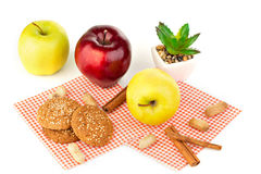 Apples, peanuts and oatmeal cookies on a white table. Apples, peanuts, oatmeal cookies and aloe flower Stock Image