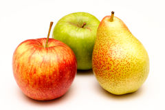 Apples and pear. A pear with green and red apples arranged on a white background Stock Images