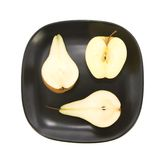 Apples and pear halfs Stock Photos