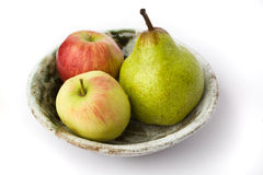 Apples and pear on the plate Royalty Free Stock Photos