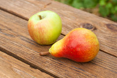 Apples and pear on wooden table Stock Photo