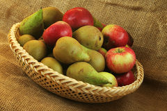 Apples and pears. On a bowl. Sackcloth background Stock Images