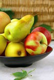 Apples and Pears. Beautiful ripe Apples and  pears on a wooden table Royalty Free Stock Photos