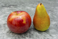 Apples and pears. Apple and pear on a canvas Royalty Free Stock Images