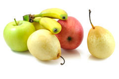 Apples, pears and baby bananas Stock Images