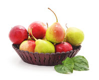 Apples and pears in the basket. Stock Images