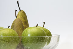 Apples and pears in glass bowl Stock Photography