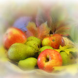 Apples and pears with maple leaves in the basket Stock Images