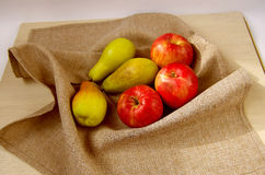 Apples and pears. Natural apples and pears laying on the napkin Stock Photos