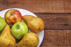 Apples and pears on rustic wood table Royalty Free Stock Photos