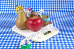 Apples and pears on scale Royalty Free Stock Photo