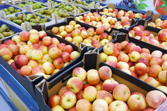 Apples and pears in supermarkets. Cardboard boxes with apples and pears in supermarkets Stock Images