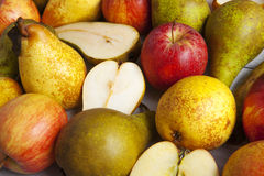 Apples and pears. Whole and halved shot close-up Royalty Free Stock Photography