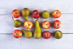 Apples and pears. Whole shot from above on white wooden boards Stock Images