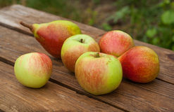 Apples and pears on wooden table Stock Photos