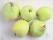 Apples and pears. On a wooden table top Royalty Free Stock Photography