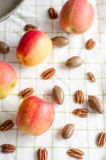 Apples and pecan nuts Stock Image