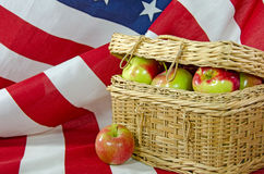 Apples in picnic basket on flag Royalty Free Stock Photo