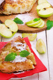 Apples pie on red napkin and mint leaves. Apples pie on red napkin , some parts of apple and mint leaves Stock Images