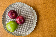 Apples in pie tin. Red and green baking apples in a pie tin from above Stock Images