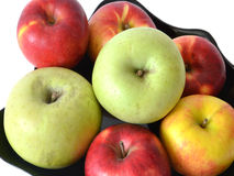 Apples pile on plate Stock Photos